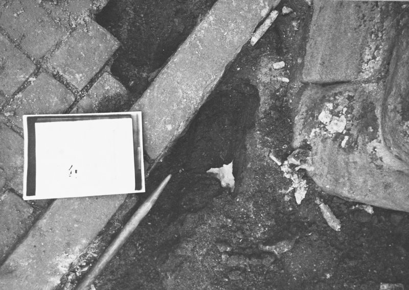 Excavation photograph - Corner of SW buttress of refectory, showing backfill of the 1975 excavation - from S
