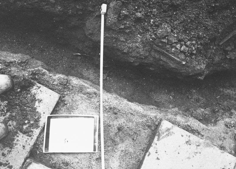 Excavation photograph - Trench III: opposite door leading onto basement of refectory, showing 1975 backfill - from N