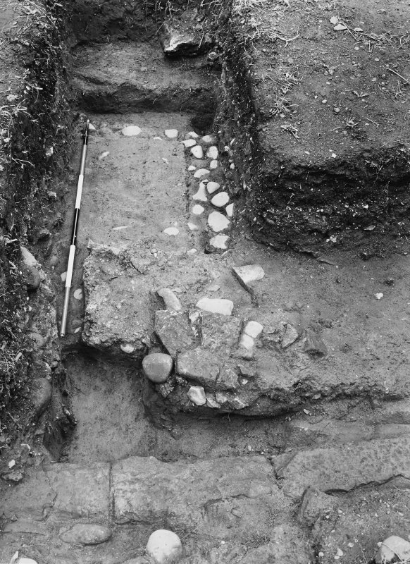 Excavation photograph of the E gate with an inverted gutter and possible foundations of the guard chamber.
