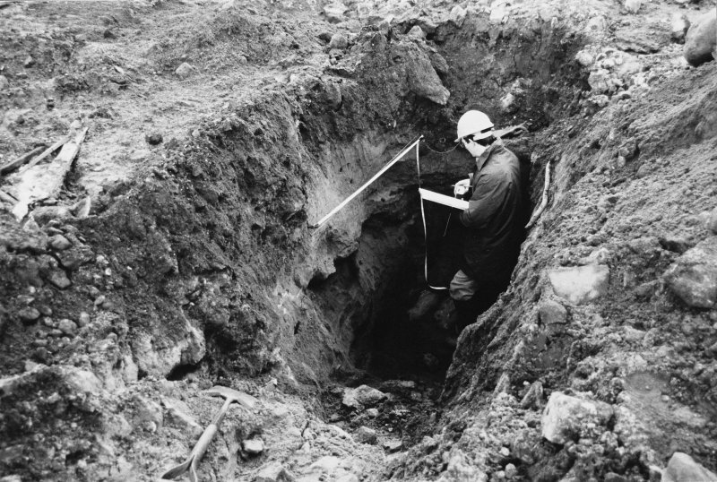 Excavation photograph : David Perry drawing west facing main section of trench A.