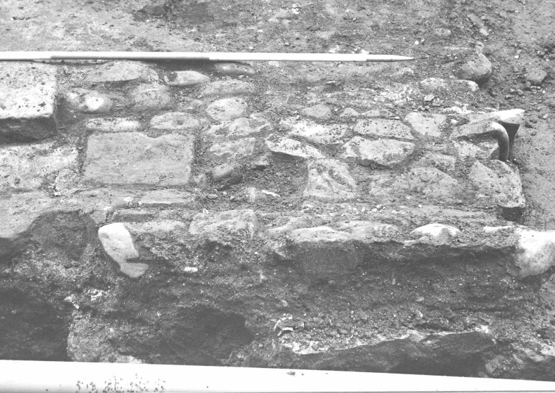 Culross Palace, Fife, Bessie Bar Hall Excavations 1993 Bessie Bar Yard Frame 00: Culvert F926 at S end of F911 Frame 0: same description as 00 Frame 1: same description as 00 Frame 2: Fireclay pipe being removed from F904 Frame 3: same description as 2  Frame 4: Section along 5m line, down to surface F927, from S Frame 5: duplicate of 4 Frame 6: same description as 4 Frame 7: Surface F927, from W Frame 8: same description as 7 Frame 9: Stone lined tank F929, from N Frame 10: same description as 9 Frame 11: same description as 9 Frame 12: Part of stone lined tank F929, from W Frame 13: Last remnant of F911 excavated from 5m line Frame 14: Same description as 13 Frame 15: same description as 13 Frame 16: Complex of drains in SE corner of yard, from W Frame 17: Base of wall on W side of palace Frame 18: same description as 17 Frame 19: Surface F927 below cobbles F910 Frame 20: same description as 19 Frame 21: W side of yard with plastic drain pie installed, from E Frame 22: Shots of stone tank F929 Frame 23: same description as 22 Frame 24: same description as 22 Frame 25: same description as 22 Frame 26: same description as 22 Frame 27: End of wall F936  Frame 28: same description as 27 Frame 29: Section at N end of service trench Frame 30: same description as 29 Frame 31: Culvert F939 Frame 32: same description as 31 Frame 33: same description as 31