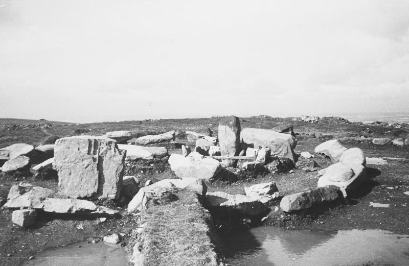 View from E of Inner kerb stones of period III cairn with the capstone of cist B.