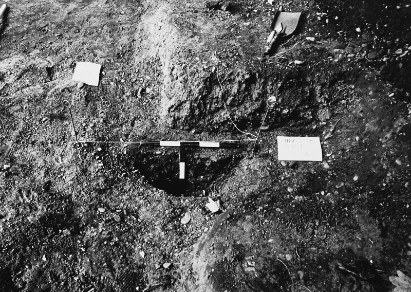 Excavation photographs: Site under excavation, including sections and close ups of finds in-situ.