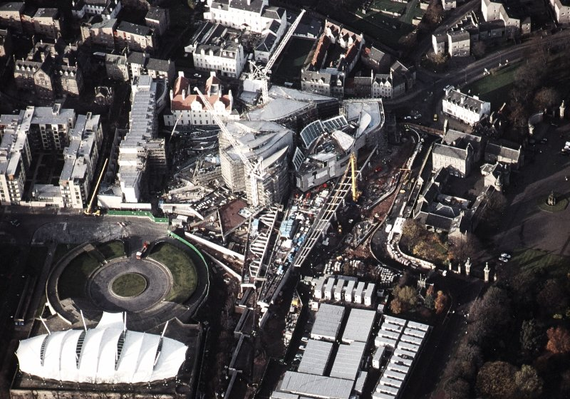 Oblique aerial view centred on the Scottish Parliament under construction with 'Our Dynamic Earth' and Queensberry House adjacent, taken from the SE.