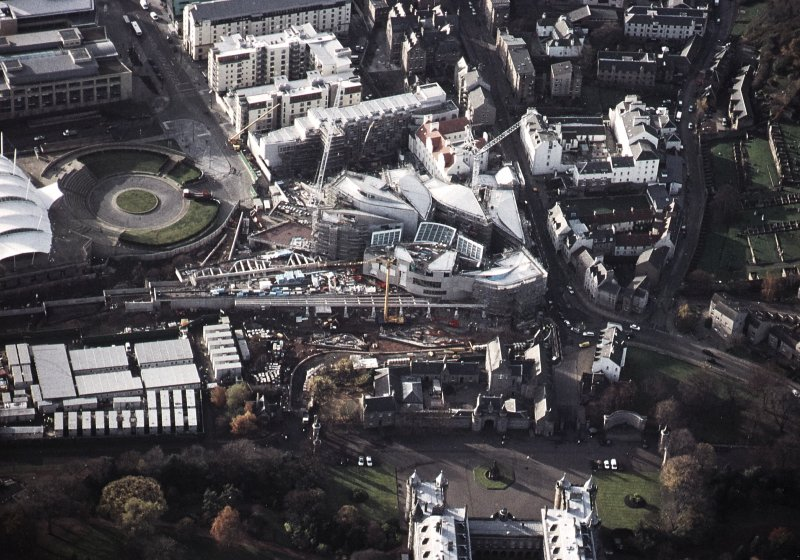 Oblique aerial view centred on the Scottish Parliament under construction with Queensberry House adjacent, taken from the E.