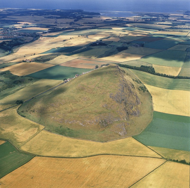 Oblique aerial view of the remains of Traprain Law fort