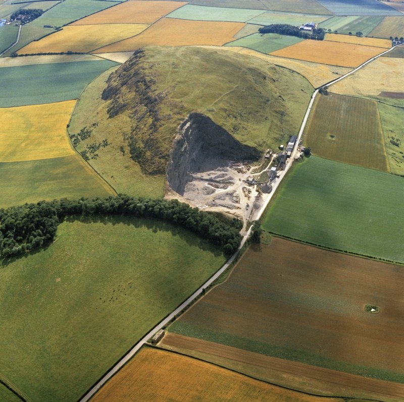 Oblique aerial view of the remains of Traprain Law fort.