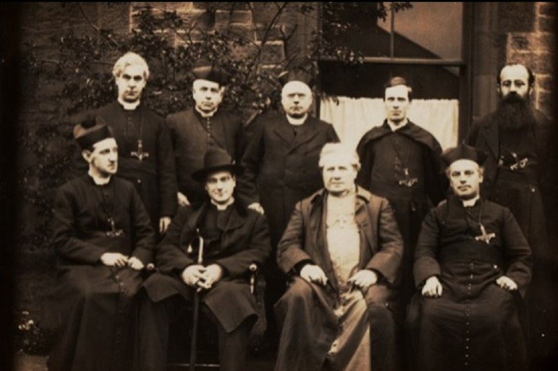 An image of 9 priests (Oblates of Mary Immaculate) taken in front of the presbytery circa 1925. They are wearing the traditional robes of catholic priests of the era. Fr Fitzpatrick was a priest at St Mary's for many years.