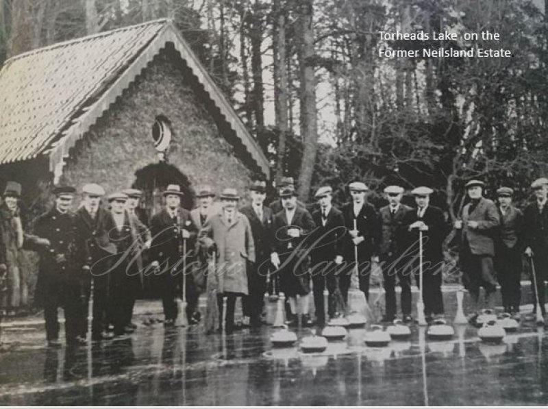 This is a Picture fo Torheads Lake with the Boat House in the Background. The Boathouse was burnt down by Vandals in the 1940s. In the Picture is Sir John Watson the Coal Master who owned this land. He is the man in the light coloured coat.