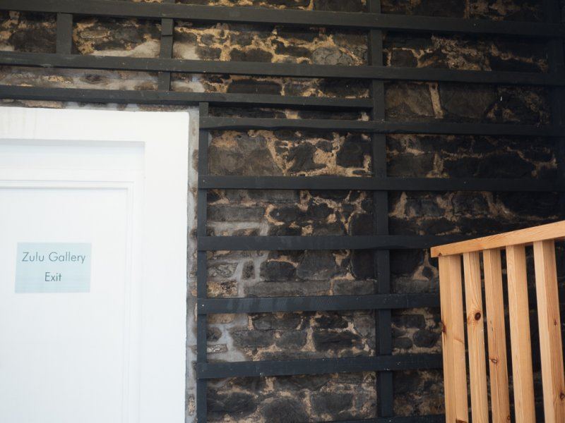 Outside wall of old smoke house incorporated into Scottish Fisheries Museum. Smoking rack on wall. Photo taken by Mia Carmichael/