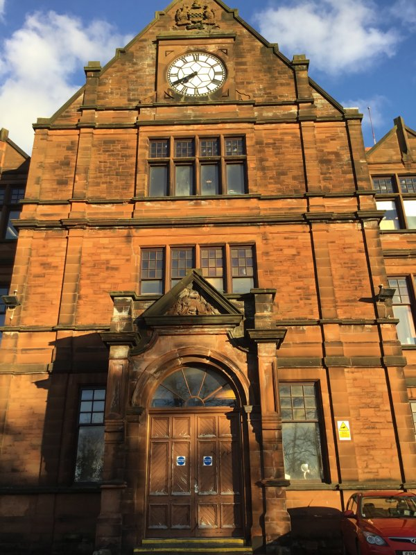 This photograph was taken of the old main entrance for the old building. It used to be used as the main entrance but it is now used as a fire exit. This picture was taken by Hayley Atherton, S2 pupil at Kilmarnock Academy 2017.