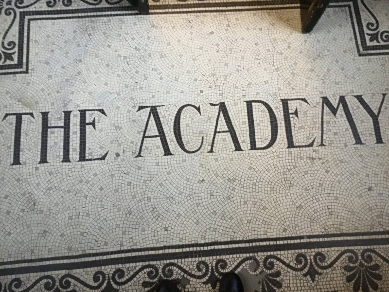 "The mosaic at the front entrance greets you with ""The Academy"". This photo was taken by Kieran Kerr, S2 pupil at Kilmarnock Academy 2017."